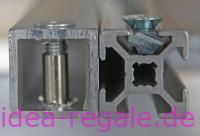 Aluminiumrrohr und Nutenprofil. Beim Aluminiumvierkantrohr starre Verbindung mit dem Rahmen, beim Nutenstein ist der Rahmen in der Höhe verstellbar, aber nicht so hoch Belastbar.